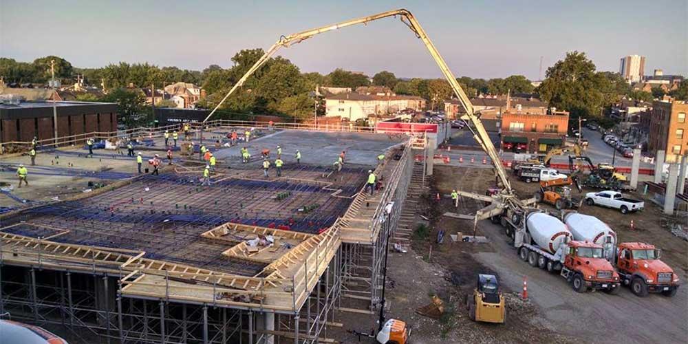 Amcrete construsction, pumping cement on building site